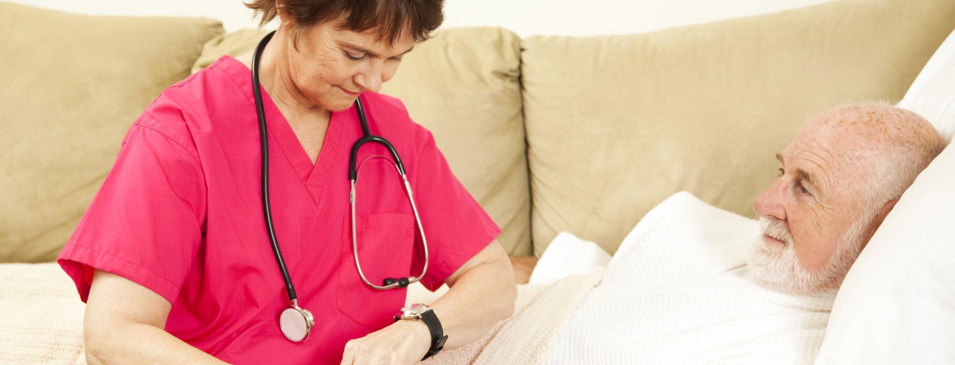 nurse taking care of old man