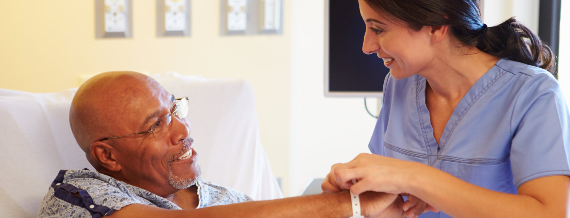 nurse taking care of man