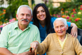 happy old couple and caregiver
