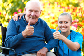 nurse and old man doing thumbs up